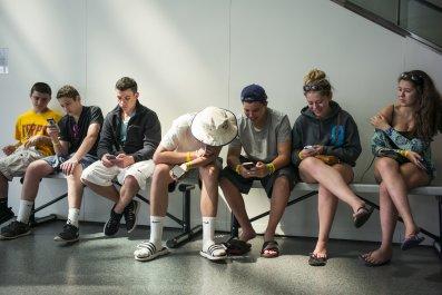Teens Look At Their iPhones