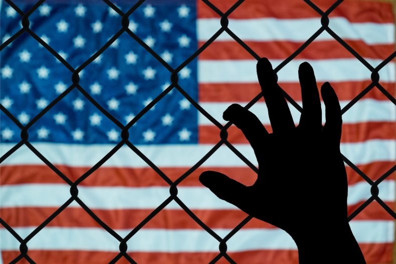 usa flag behind fence