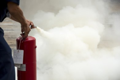 Man spraying a fire extinguisher