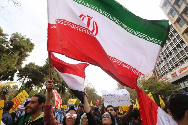 iran protest flag us embassy tehran