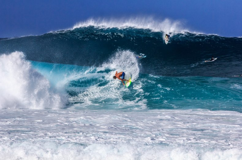 Surfers n the North Shore of Hawaii on the Island of Oahu