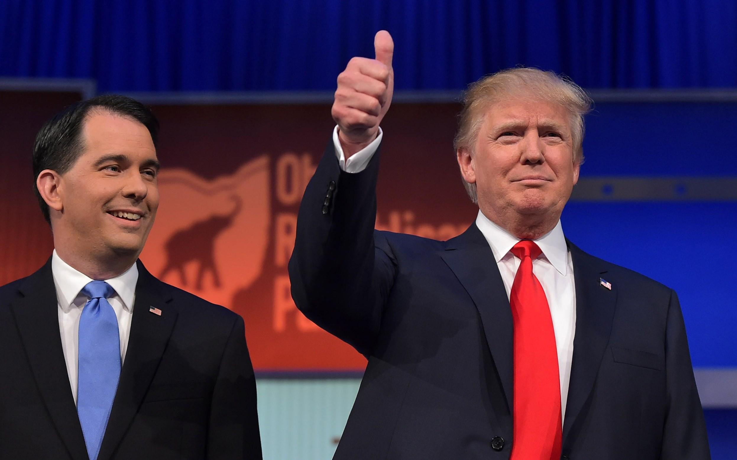 "Former GOP Gov Scott Walker said he fears Bernie Sanders' ""authentic"" campaign resonates like Donald Trump's"