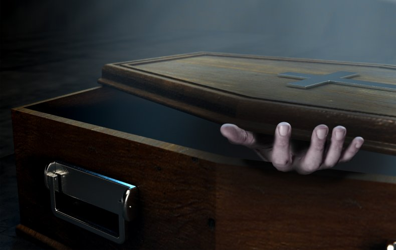coffin with hand