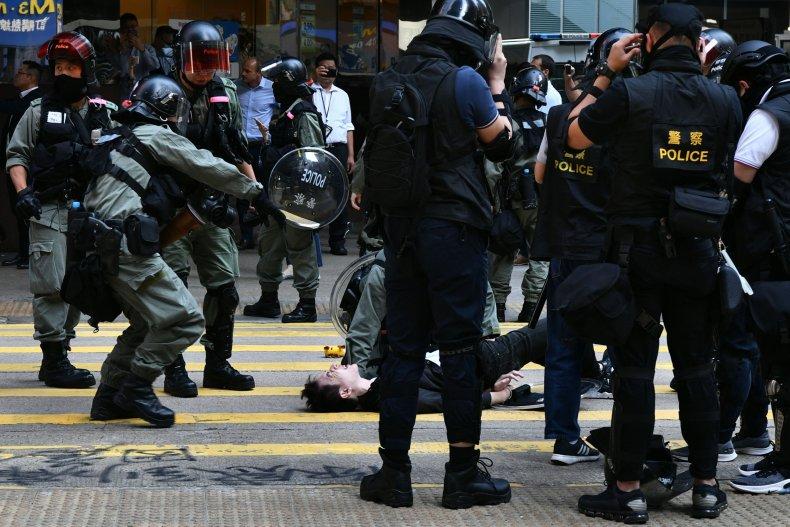 Hong Kong, protester, shot, China, police, die