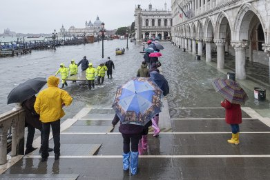 Tourists crossing Piazza San Marco