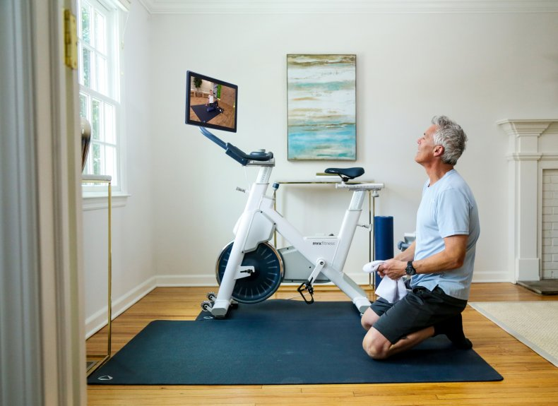 Man Using Tablet to Workout