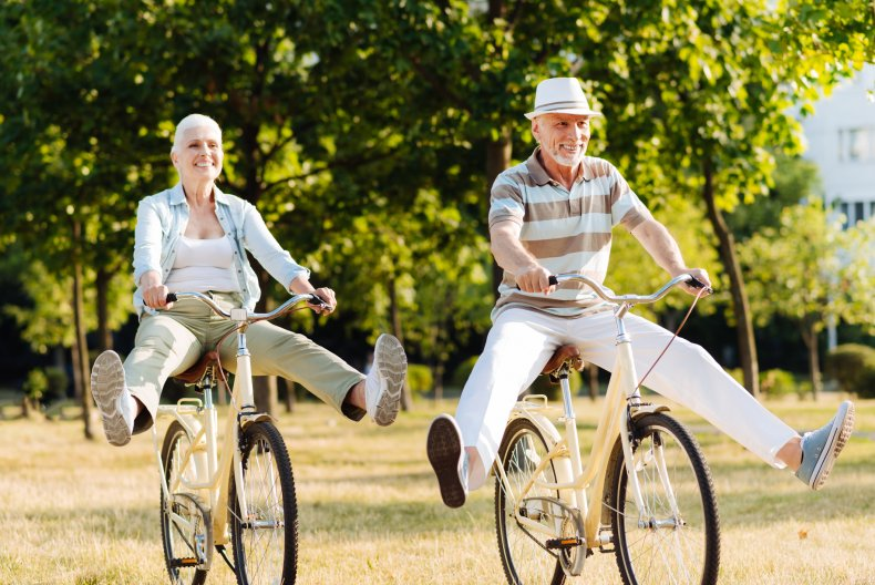 Baby boomer couple on bicycles