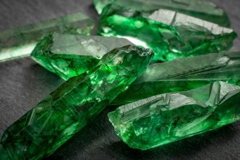 Close up photography of uncut emeralds