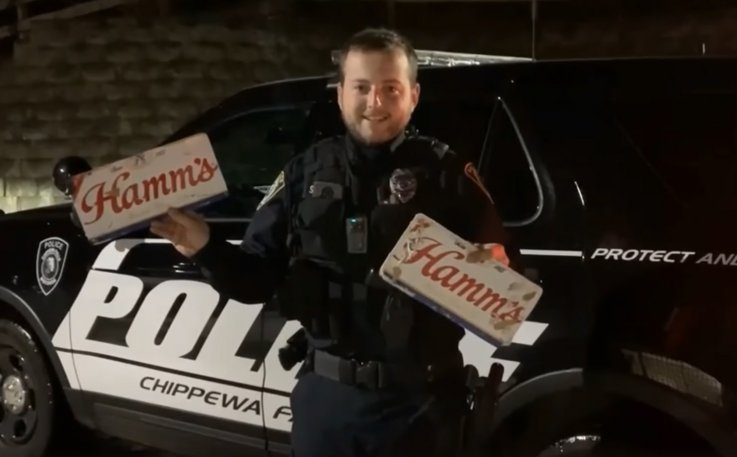 Officer Scott Schoenwetter showing off beer plates