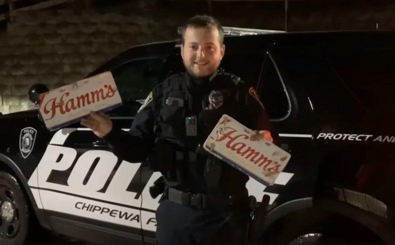 Officer Scott Schoenwetter showing off beer plates