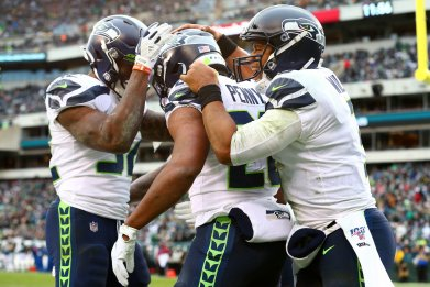 Rashaad Penny, Russell Wilson, Seattle Seahawks