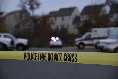 Police tape in front of crime scene