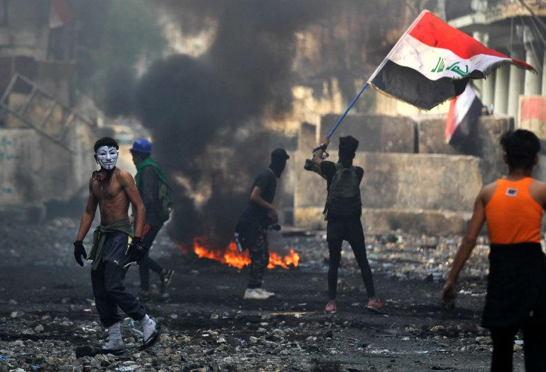 iraq baghdad protests fire flag