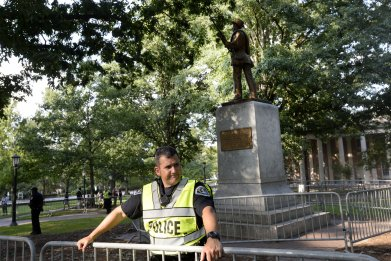 Police officer guarding Silent Sam