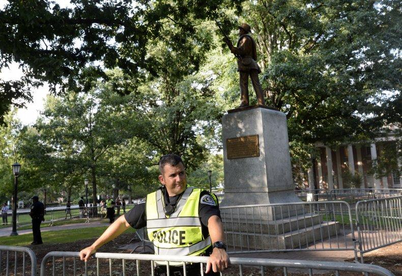 Police officer guarding Silent Sam