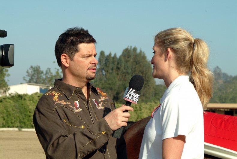 Erich Mancow Muller interviewing stablehand