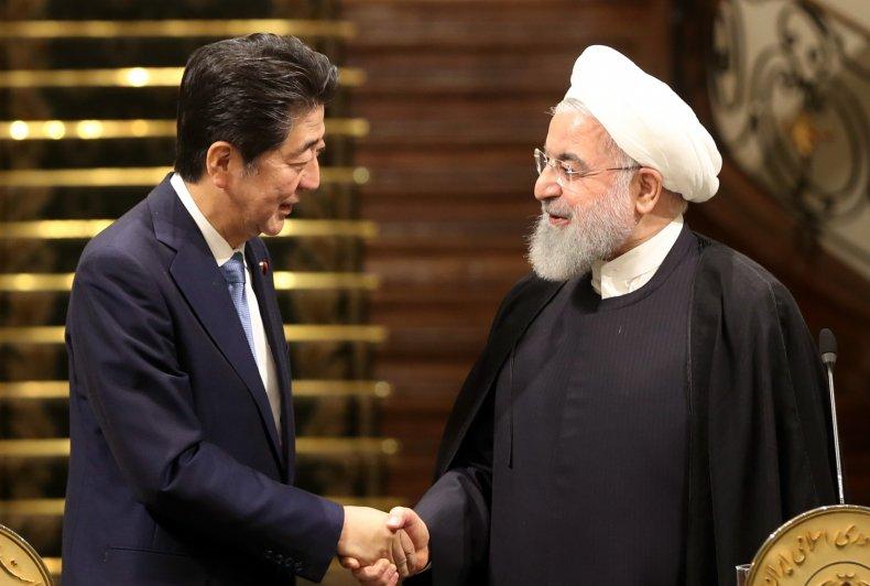 Iranian President Hassan Rouhani Japanese Prime Minister Shinzo Abe
