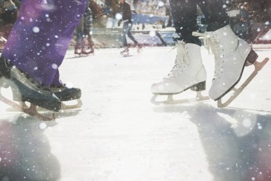 Ice skaters on an ice rink