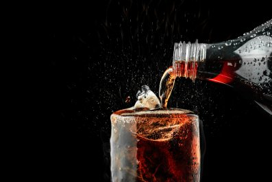 Soda being poured into a glass