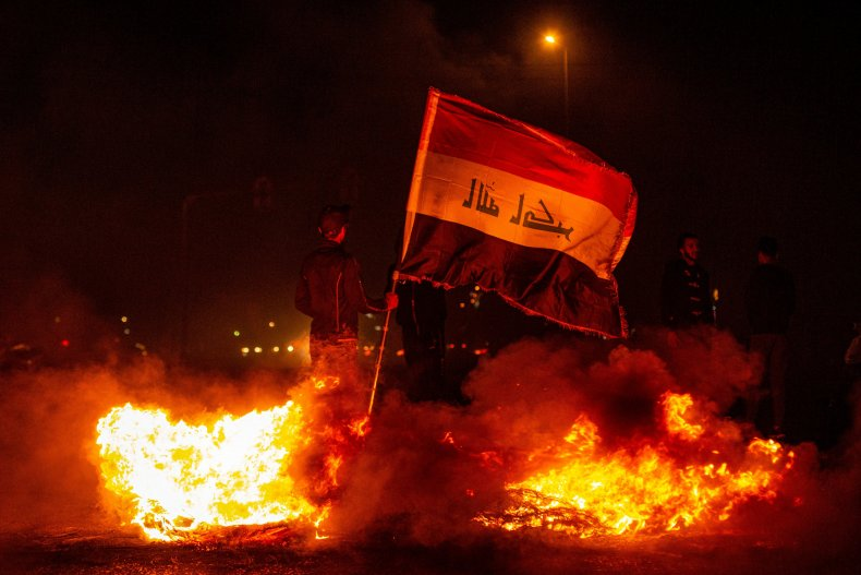 iraq, protests, basra, flag, flames