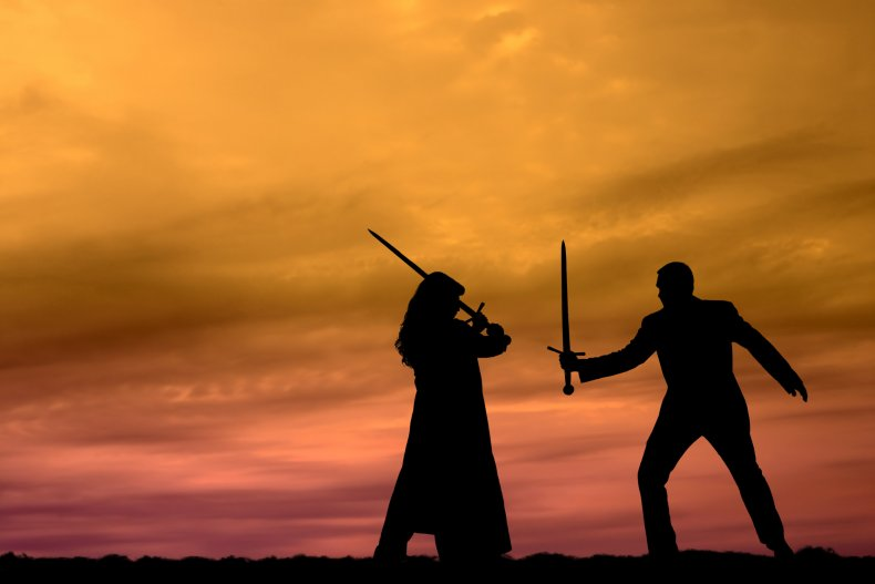 woman and man sword fighting