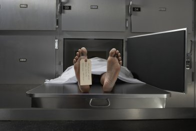A corpse on a morgue table