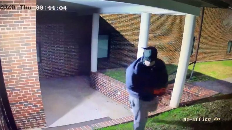 Surveillance image of Batman church robber