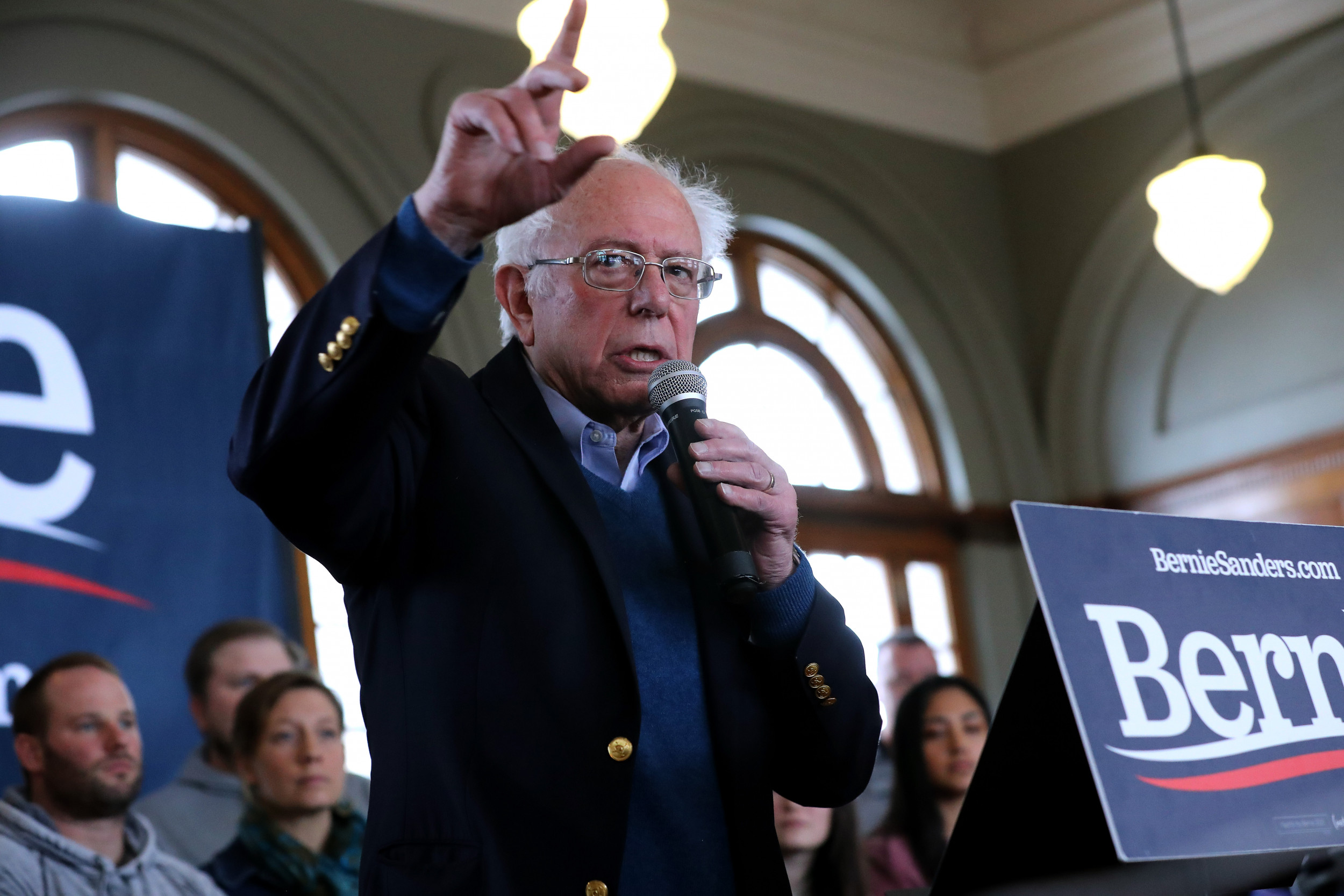 """Bernie Sanders vows to reverse """"every single thing"""" Trump has done on immigration as he surges to first in New Hampshire poll"""