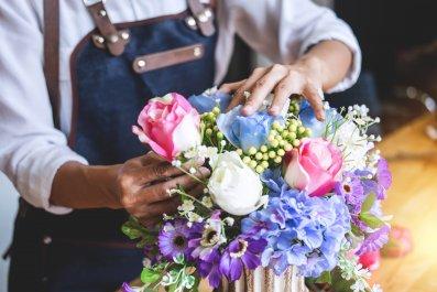 A florist arranging a bouquet