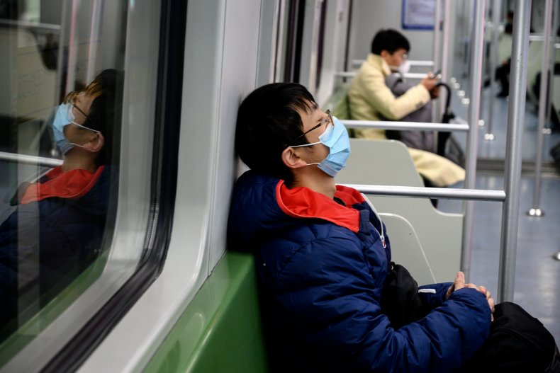 Passenger wears mask on subway