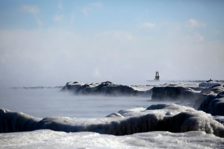 Ice covers Lake Michigans shoreline