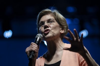 Elizabeth Warren, Donald Trump, coronavirus, racist, wall