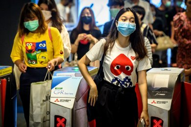 Commuters wearing facemasks