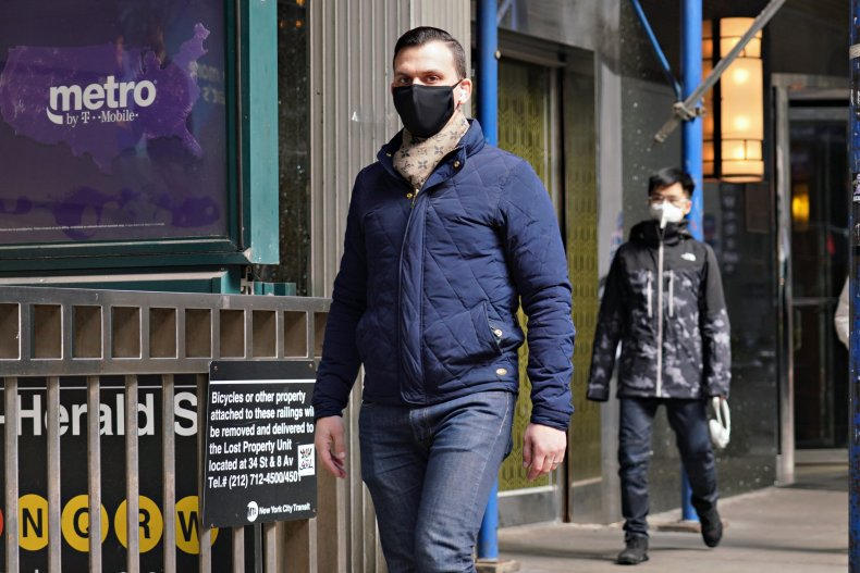 A masked pedestrian in New York City