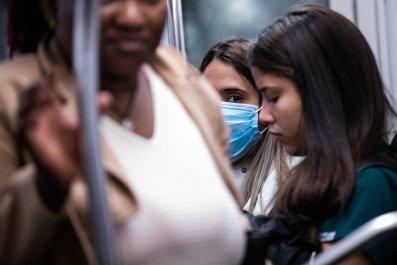 Woman rides subway mask