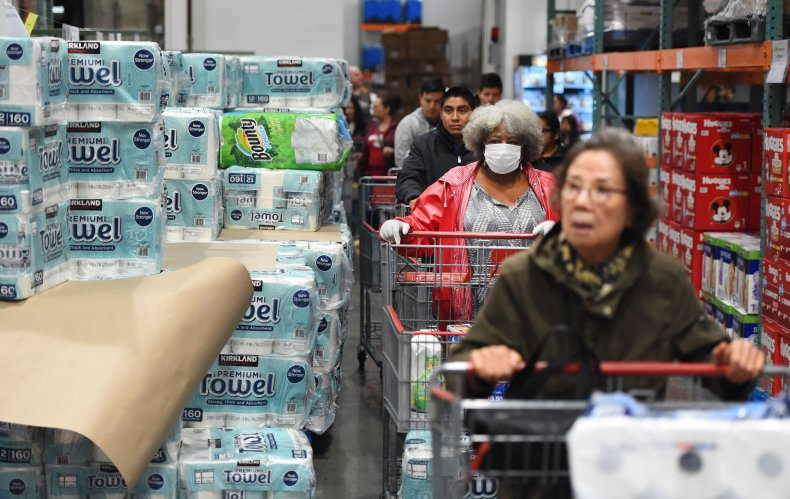 Shoppers wait to collect toilet paper at a Costco