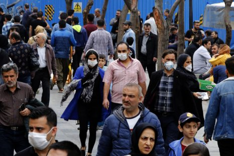Iranians wearing masks