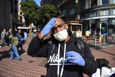 Pedestrian San Francisco wearing mask Feb 2020