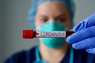 coronavirus worker with mask and gloves