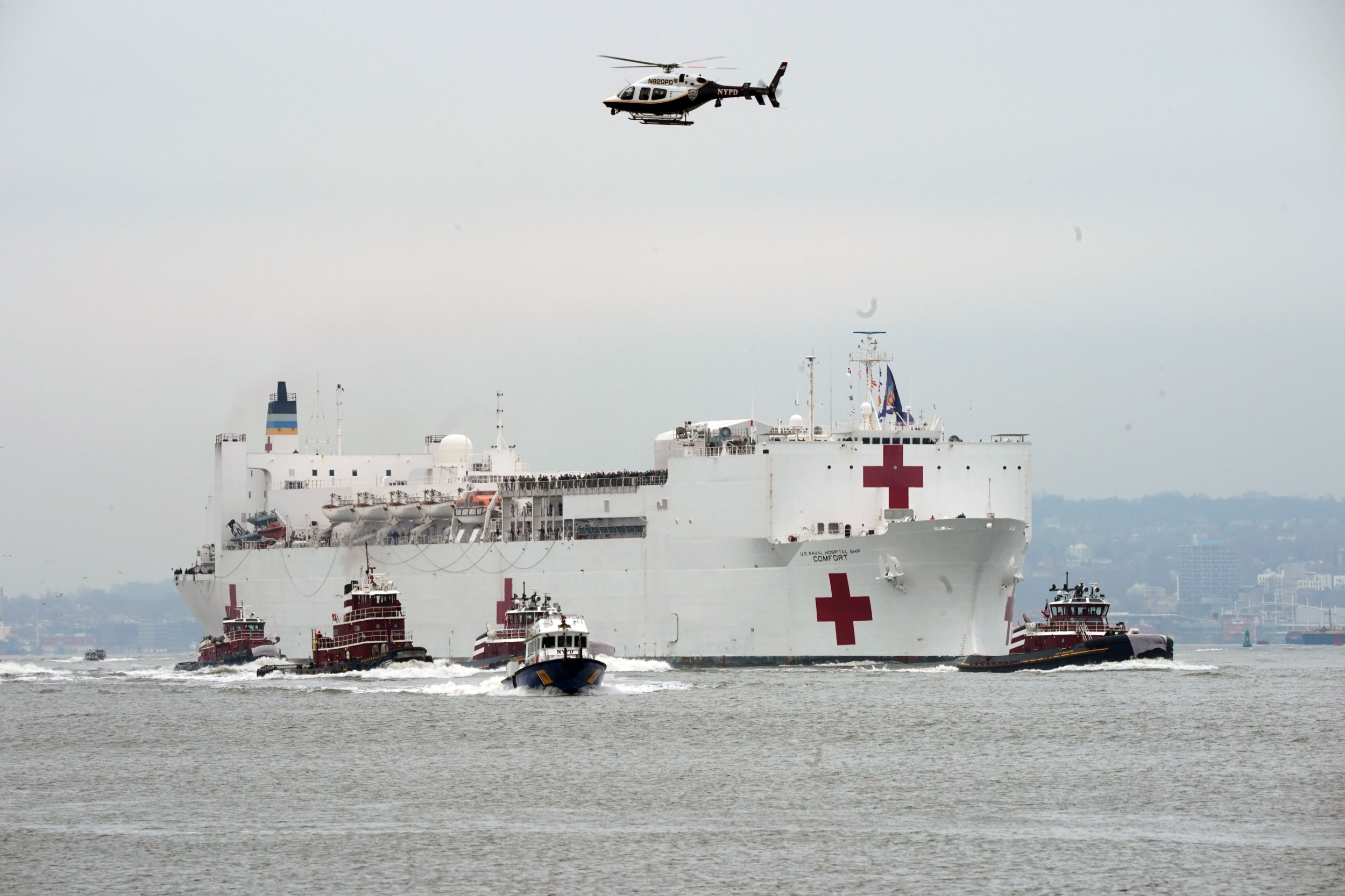 Crowds Gather to See Navy Hospital Ship Dock in NYC Amid COVID-19 Pandemic - Newsweek