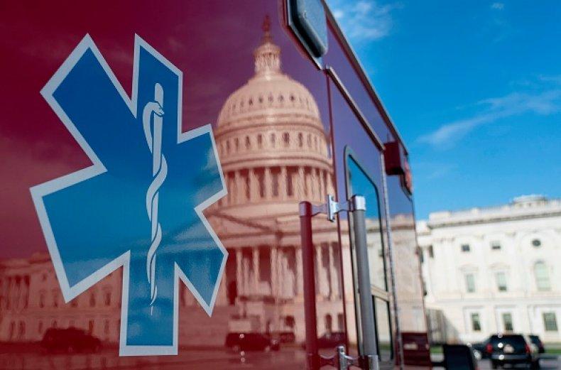 us capitol reflected ambulance coronavirus pandemic