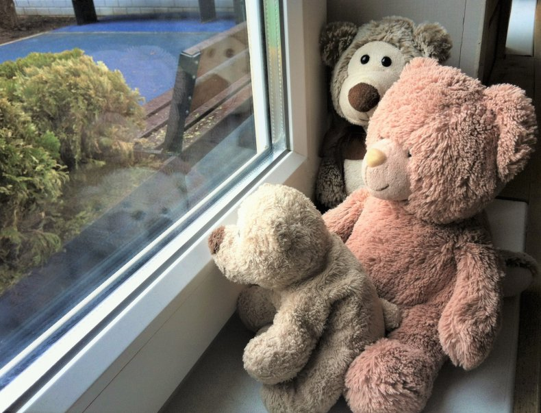 Teddy bears in window