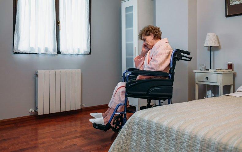 Senior in nursing home room