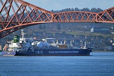 Gas Tanker Sails Under Bridge