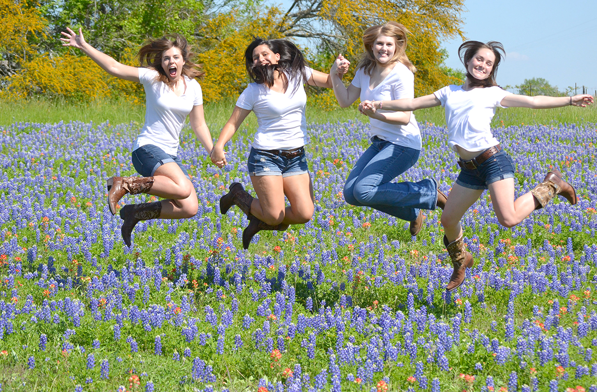 Texas Girls Jumping in Bluebonnets