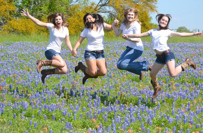 Texas Girls Jumping in Bluebonnets