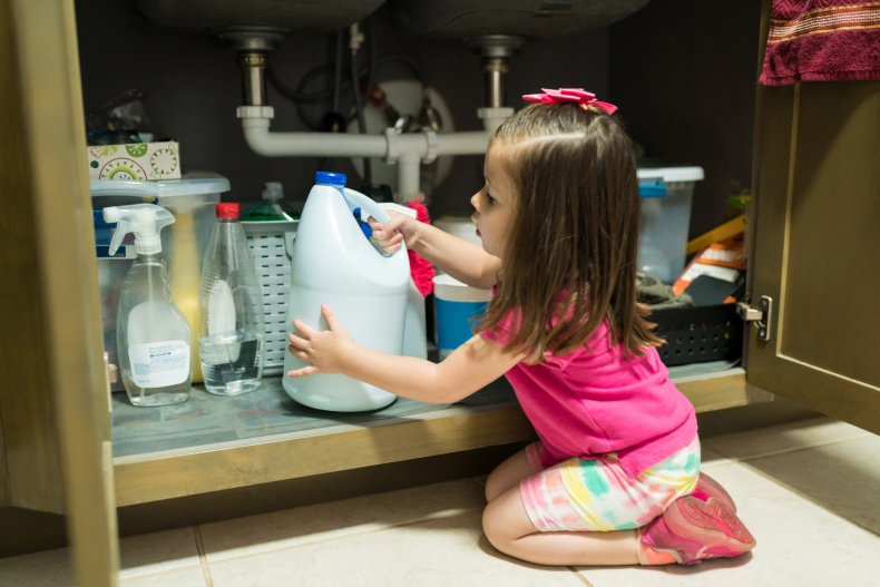 Child grabbing bottle of bleach
