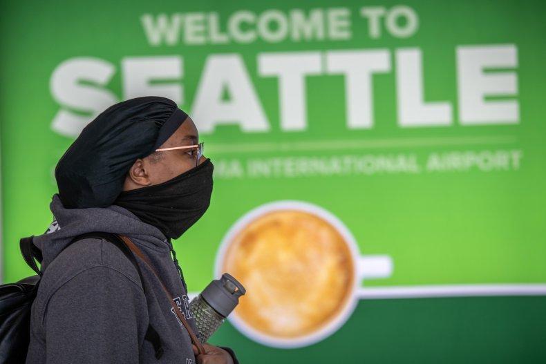 Seattle airport, Washington, Coronavirus, mask, March 2020