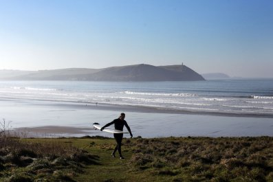Surfer Polzeath Cornwall UK