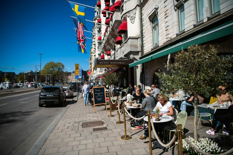 People have lunch at a restaurant in Stockholm on April 22, 2020